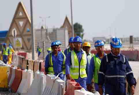 Workers walk towards the construction site of the Lusail stadium which will be build for the upcoming 2022 Fifa soccer World Cup during a stadium tour in Doha, Qatar, December 20, 2019.  REUTERS/Kai Pfaffenbach