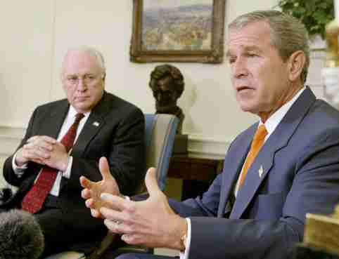 """U.S. President George W. Bush answers questions from the press aboutIraq with Vice President Richard Cheney (L) looking on, during ameeting with Congressional leaders at the White House, September 18,2002. The president said Saddam Hussein """"won't fool anybody"""" with hispromise to admit weapons inspectors into his country. REUTERS/LarryDowningLSD/HB"""