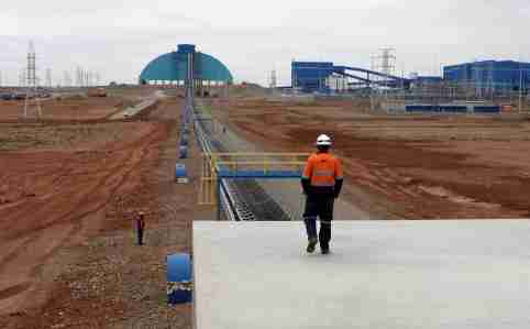An employee looks at the Oyu Tolgoi mine in Mongolia's South Gobi region June 23, 2012. REUTERS/David Stanway/File Photo