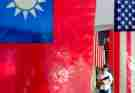 People with face masks walk past US-Taiwan which are hung outside a restaurant , amid US's ever-changing partnership with Taiwan and the escalating tensions between Taipei and China, in Taipei, Taiwan, 10 August 2021. The US-Taiwan tie is switching to a rapport  through military, political, economy, and medical commitments and collaborations including arms sale and trade deals  whilst the intensifying threats of China unifying Taiwan have brought uncertainty to the stability of regional security for south east Asia, according to some critics. (Photo by Ceng Shou Yi/NurPhoto)NO USE FRANCE