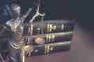 Statue of blind justice and law text books.