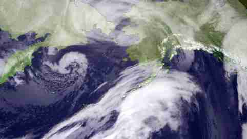 This composite infrared imagery from NOAA weather satellites taken November 9, 2011 shows the storm moving over the Bering Strait region, bringing heavy winds and flooding to western Alaska. The storm, moving inland from the Aleutian Islands, was expected to bring hurricane-force winds with gusts up to 100 miles per hour, heavy snowfall, widespread coastal flooding and severe erosion to most of Alaska's west coast, the National Weather Service said. REUTERS/NOAA/Handout (UNITED STATES - Tags: ENVIRONMENT)