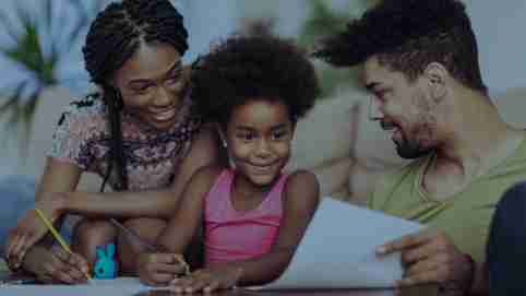 Parents helping child with schoolwork