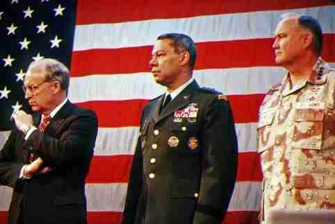 U.S. Secretary of Defense Richard Cheney, General Colin Powell, Chairman Joint Chiefs of Staff and General Norman Schwarzkopf, Commander, U.S. Central Command, stand during an award ceremony prior to the Welcome Home parade honoring the coalition forces of Desert Storm, in an undated file photograph in New York City, U.S. SSgt. Charles Regne/U.S. Army/Handout via REUTERS.
