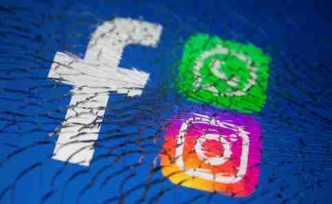 Facebook, Whatsapp and Instagram logos are displayed through broken glass in this illustration taken October 4, 2021. REUTERS/Dado Ruvic/Illustration