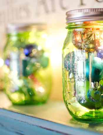 Make Mason Jar Christmas Lights and Ornament Display with simple steps and items. A DIY Christmas Mason Jar perfect for the table or shelf.