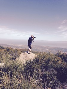 Steve precariously taking picture from overlook of Santa Barbara on ridge road