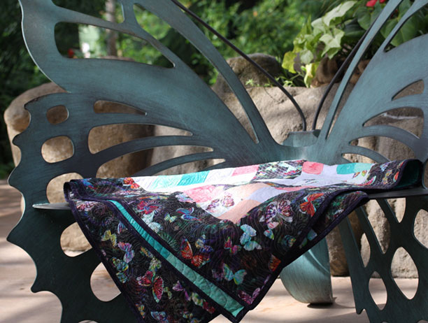 butterfly chair with quilt
