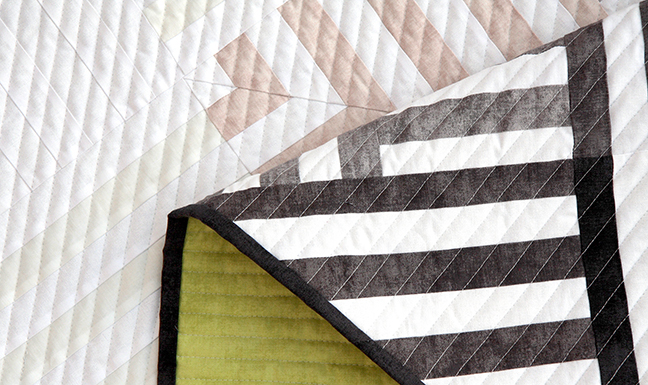 Close up on a modern quilt using Shades fabric from Riley Blake Designs