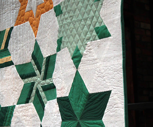 I quilted this quilt on a long arm and on a domestic machine