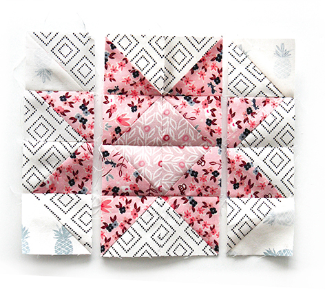 I love how you can turn your Half Square Triangle scraps into a beautiful block.
