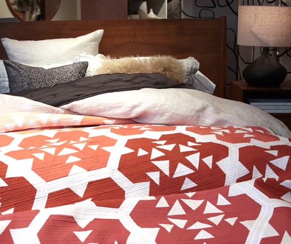 Terracotta Fiori Quilt Pattern on a bed