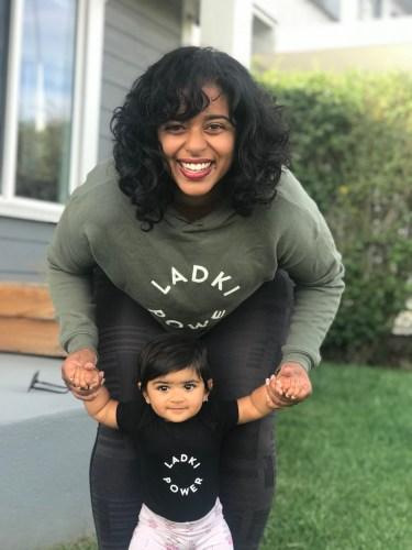 Mother & Daughter Laughing & Posing