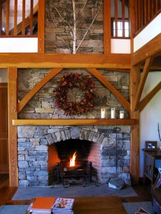 Ashlar Stonework, Arched Opening, Wood Timber Mantel, Flush Single Piece Schist Hearth.