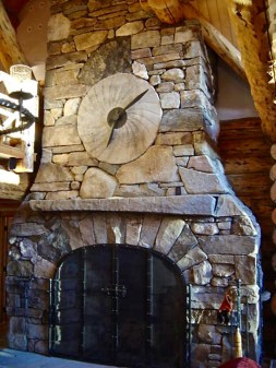 """Large Weathered Fieldsone, """"Dry-Stack"""", Arched Opening, Millstone Clock, Stone Mantel, Flush Large Flagstone Hearth"""