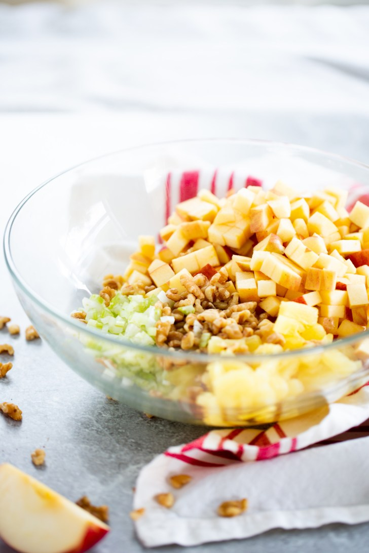 apples and other ingredients to make christmas salad