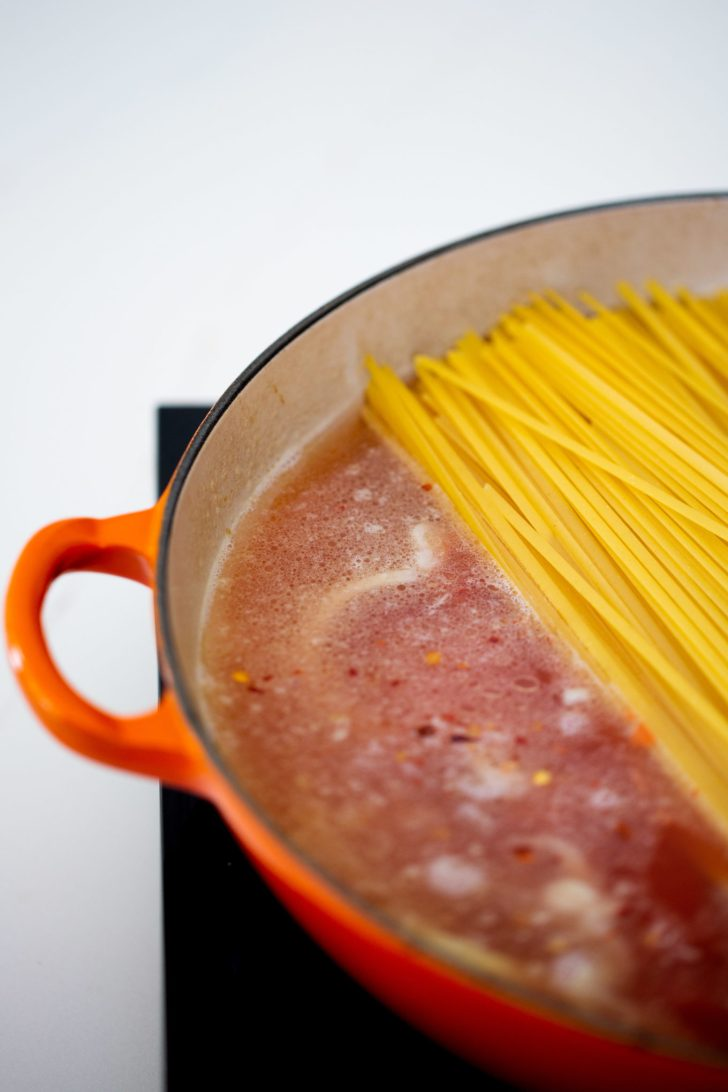 Pasta in a pan being cooked