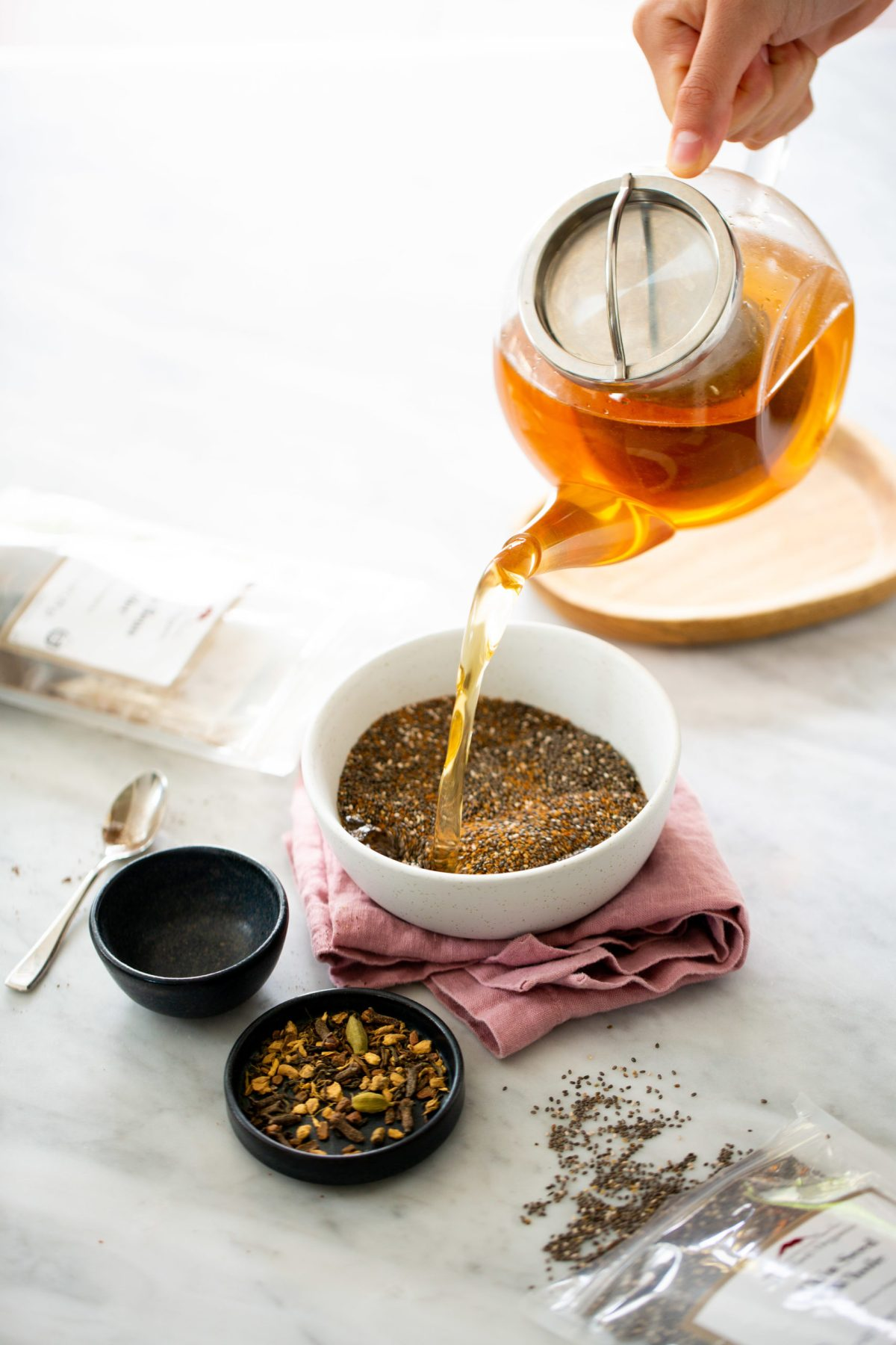 classic chai tea being poured over chia seeds