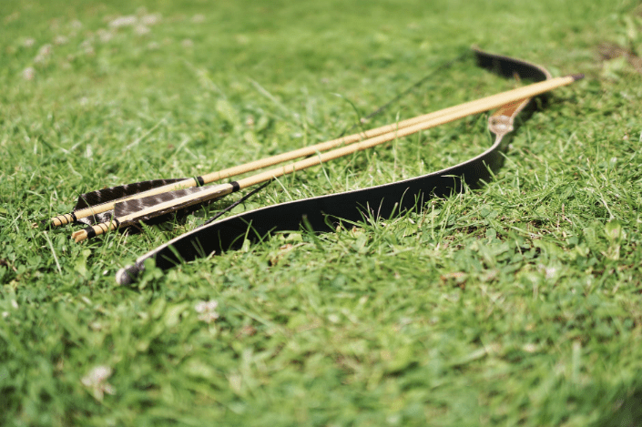 a wooden bow on the grass
