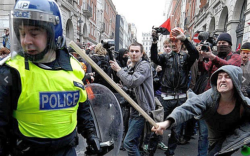 Left wing protestor attacks policeman