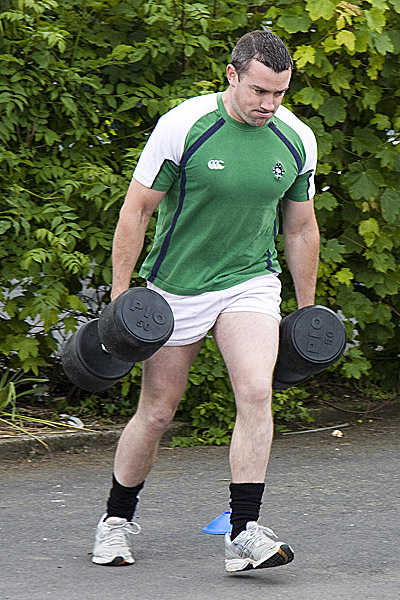 """The traditional """"Farmers Walk"""" with two 8 Stone Weights."""