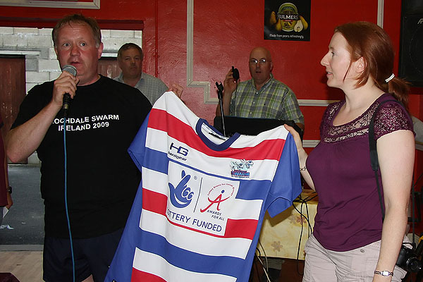 Rochdale present Gráinne with a jersey.