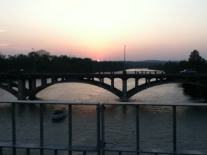 The setting sun as seen from the Pfluger Pedestrian Bridge.