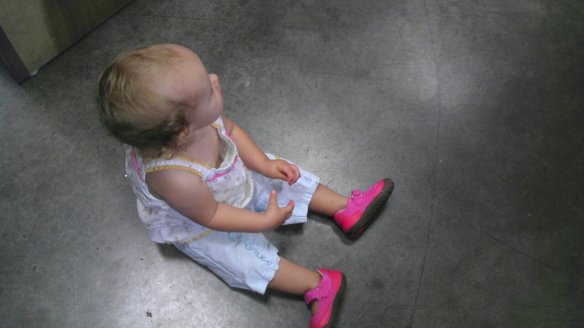 Madeline sits on the floor, wearing pick shoes