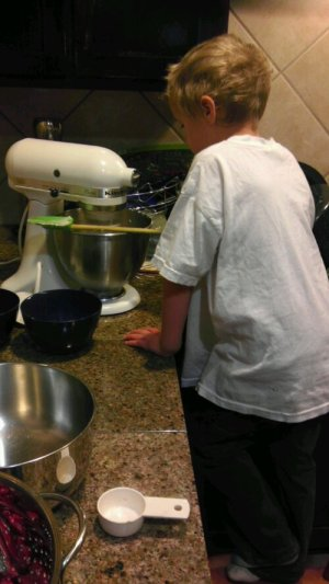 Luke looks into the stand mixer bowl