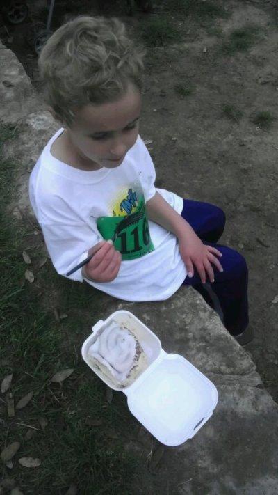 Luke eating a cinnamon bun