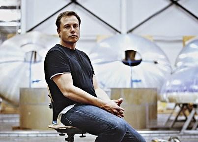 Elon Musk sitting down