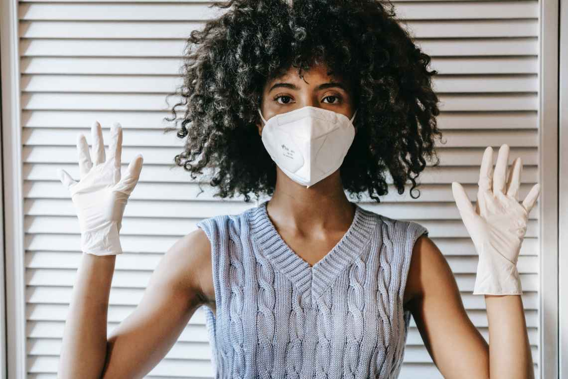black woman in mask and gloves