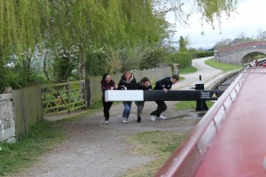 Staff team operating lock gate during a residential on a canal boat.