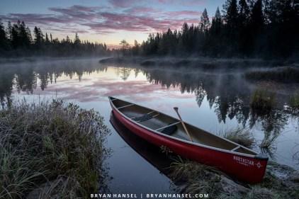 red canoe at sunrise