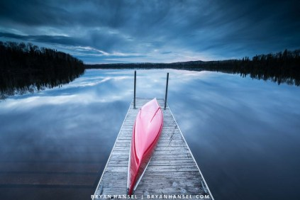 red canoe on a dock