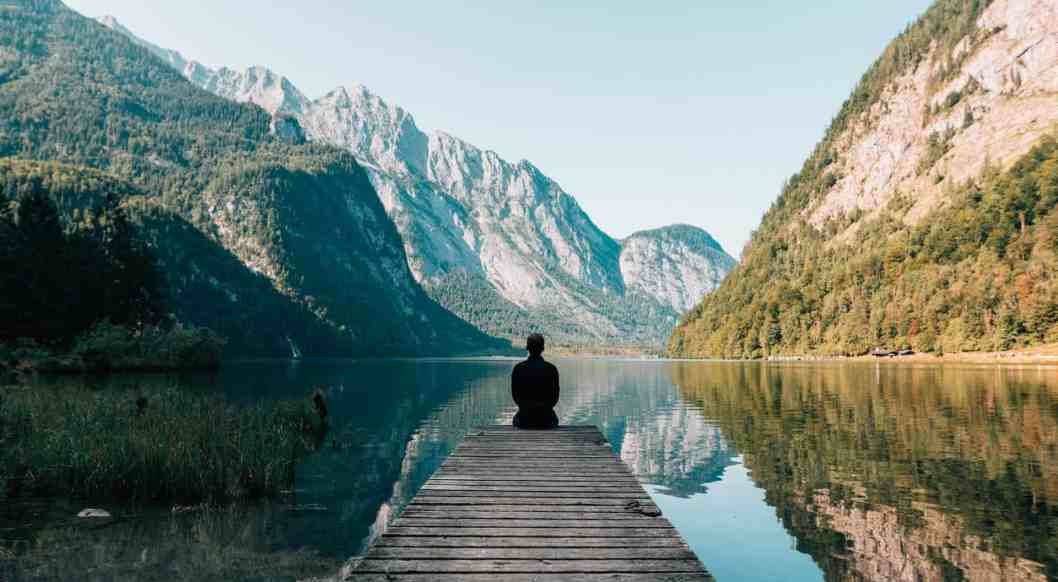 man quietly sitting end of dock experience god personally