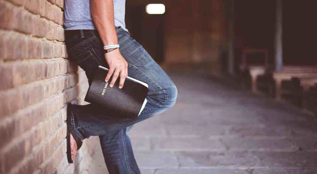 man with closed bible in hand