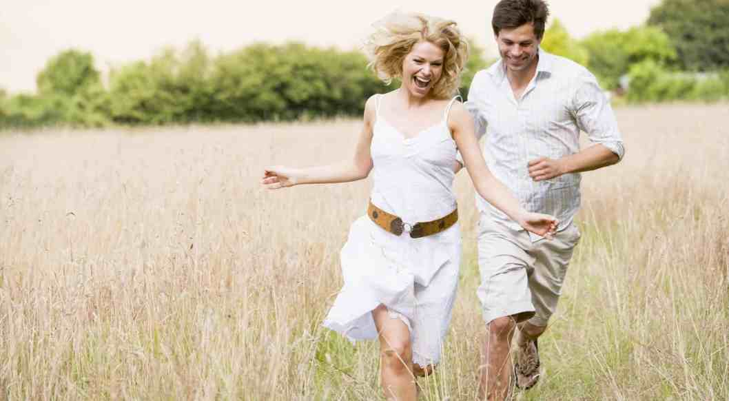 how to prepare for marriage; happy couple running together in a field