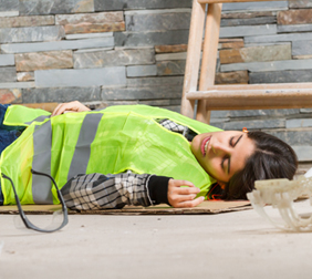 san antonio accident attorney woman hurt on the job lying on the ground