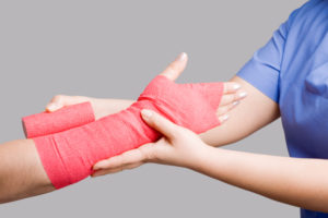 Applying bandage San Antonio Accident Attorney