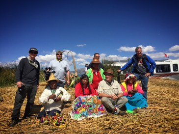 Crew poses with the locals at Lake Titicaca, Peru.