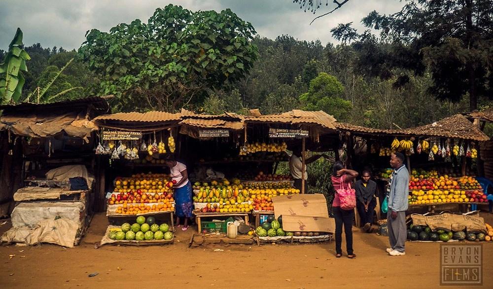 People shopping at a Kenyan fruit market