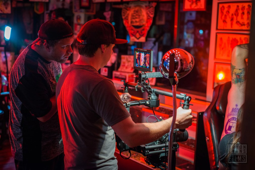 Checking the frame for one shot commercial for Evolution Tattoo