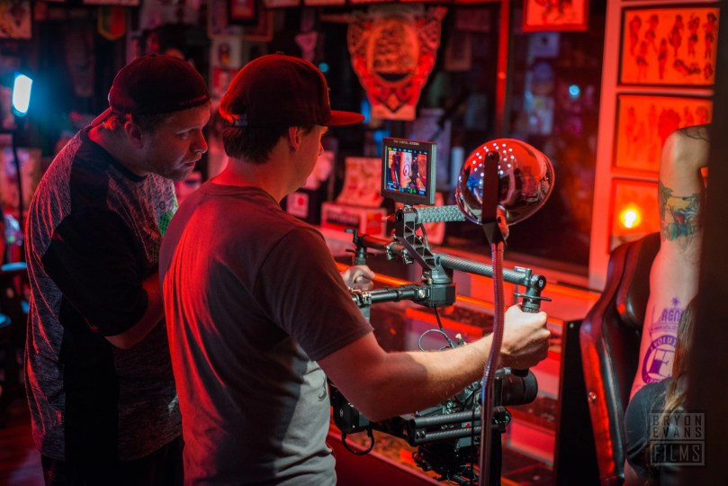 Checking the frame for one shot commercial video production for Evolution Tattoo.