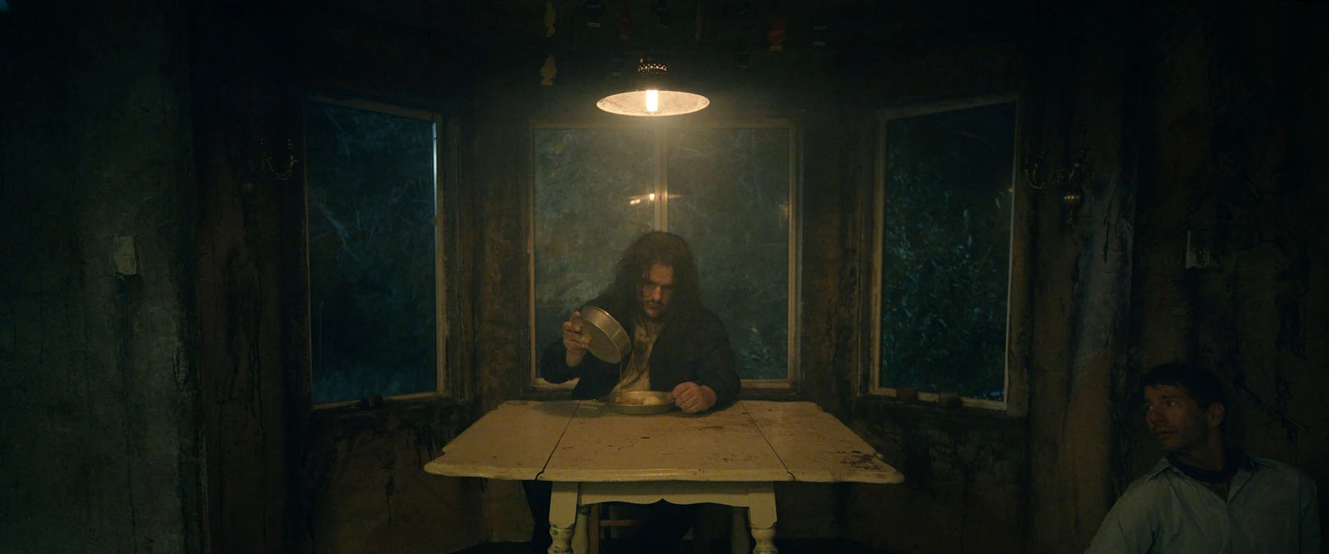 frame grab of a man at a table from the horror/comedy short film Inflatio