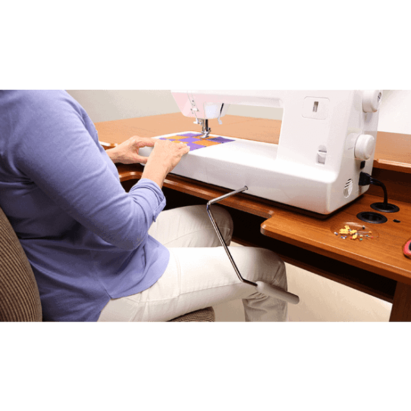 Hands-Free Presser Foot Lift.  Keep both hands free for sewing large quilts.  Start and stop your sewing without ever taking your eyes - or hands - off your project. (BLMJZ)