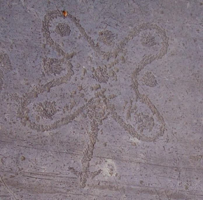 La rosa camuna nelle incisioni rupestri