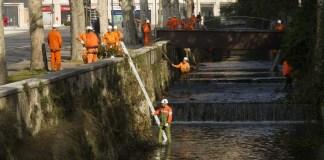 Intervento di pulizia del fiume Garza da parte dei volontari dell'Associazione Nazionale Alpini