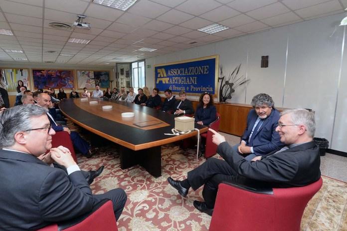 Il vescovo Pierantonio Tremolada ad Associazione Artigiani, foto da ufficio stampa