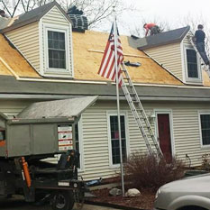 picture of brightside home restoration service in medina ohio doing some roofing services to a home